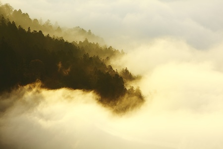 dramatic Clouds rolling over mountains at sunset shot in taiwan formosa asia photo