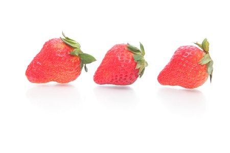 Three strawberries and reflection isolated on white background photo