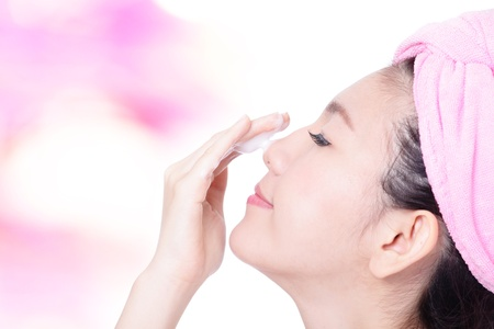 Young Girl Clean Face with foam on hand on pink background, model is a asian beauty