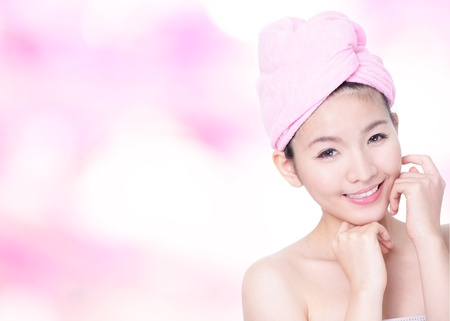 Young Woman Closeup portrait with Smile Face after bath - spa on pink background, model is a asian beauty Stock Photo