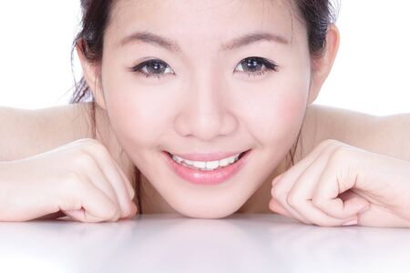 Smile face close up of a beautiful woman with health skincare isolated on white background, model is a asian beauty photo