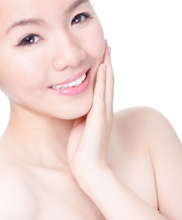 Portrait of beautiful woman touching her pretty face with healthy skin - isolated on white background, model is a asian beauty photo