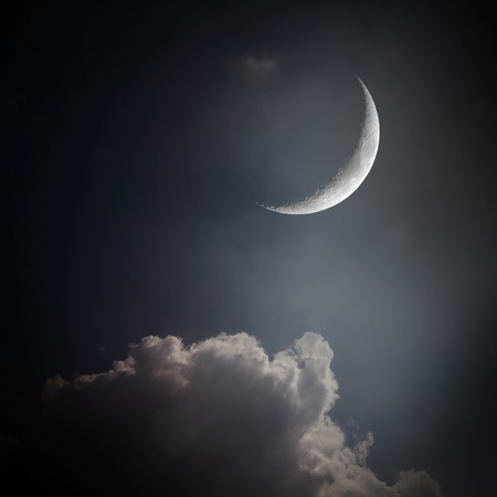 the mystery half crescent moon at the night sky with cloud
