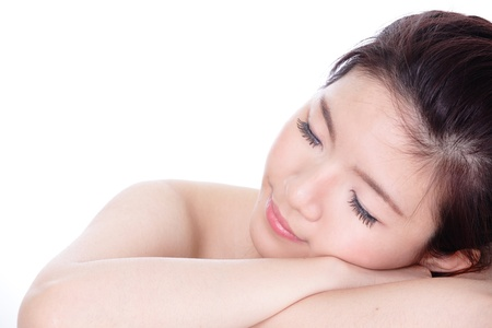Sleep Woman close up portrait, isolated on white background, model is a asian girl photo