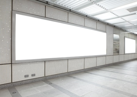 bus station: Blank billboard in the city building, shot in subway station, white empty copy space is great for user