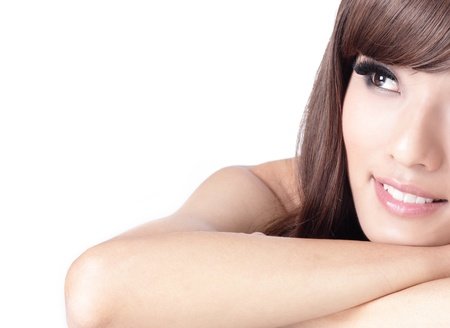asian woman face: pretty girl smile face and look to blank copy space , model is a asian woman