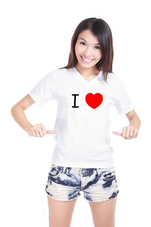add text: Young asian Girl Happy show white T-Shirt with Text (I love) isolated on white background, buyer could add any text on empty area in the image Stock Photo