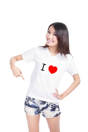 Young asian Girl Happy show white T-Shirt with Text (I love) isolated on white background, buyer could add any text on empty area in the image photo