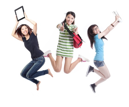 happy people jumping: Excited group of girl students jumping - isolated over white background, model are asian people