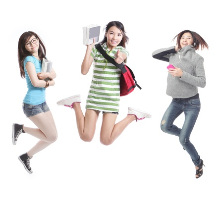 Excited group of girl students jumping - isolated over white background, model are asian people
