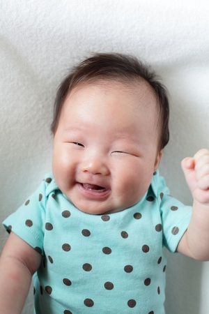 funny baby smile face close up (baby are two months) , child is a asian girl Stock Photo - 13260546