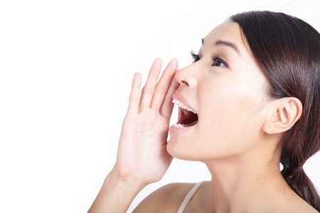 blab: Yelling woman mouth closeup isolated on white background, model is a asian beauty
