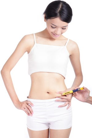 Man help woman inject drugs to prepare for IVF treatment isolated on white background, model is a asian beauty photo