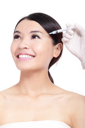 Cosmetic botox injection in woman face. Eye zone. Isolated on white background, model is a asian beauty photo