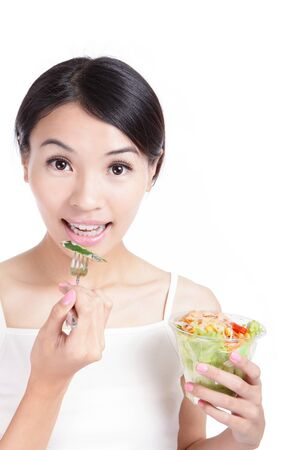 smile close up: Young Girl Smile eating salad isolated on white background, model is a asian woman