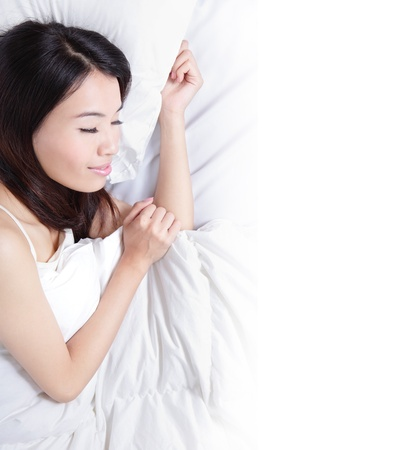 asian home: Woman sleeping on the bed in the morning with empty copyspace isolated on white background , model is a asian beauty Stock Photo