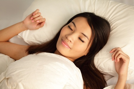 Young girl sleep peaceful on home bed at night , model is a asian woman Stock Photo - 13393704