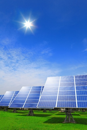 Solar panel system ,blue sky and sunshine with green grass Stock Photo - 13577963