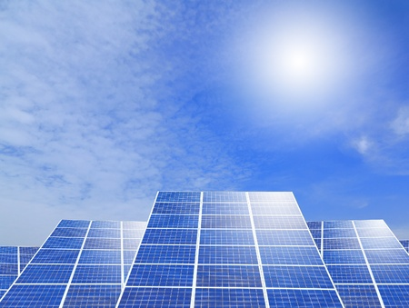 Solar panel system ,blue sky and sunshine with green grass photo
