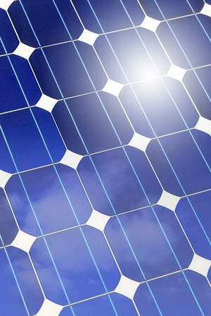 solar cell: Solar panel (cell and battery) detail and closeup with sky and sun reflection