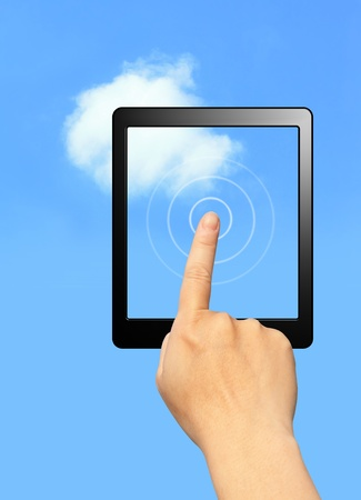cloud computing concept. hands touch computer screen with tablet and touch pad in sky background photo