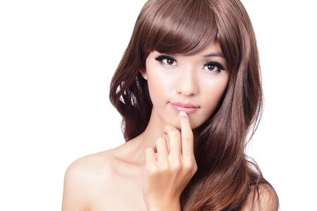 Pretty portrait, closeup face and hand touching lips, looking at camera, isolated on white background, model is a asian beauty photo