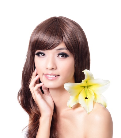 Pretty beautiful woman hand touch face with smile and white lily in her hairs isolated on white background, model is a asian beauty photo