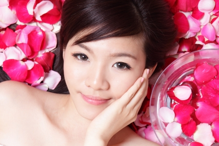 face close up: Asian beauty Girl Face close up with red rose, and touching her face, concept for health spa Stock Photo