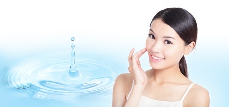 Skincare woman hand touch face with smile , water drop background, concept for cosmetic, beauty hygiene, makeup, moisturize, model is a asian beauty photo