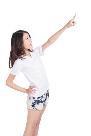 woman pointing up: Young woman point to copy space by hand finger Stock Photo