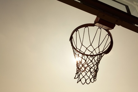 hoops: silhouette of Basketball Basket in the sunset Stock Photo