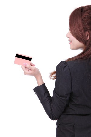 Side view of asian business woman smiling holding credit card and looking at copyspace isolated on white background photo