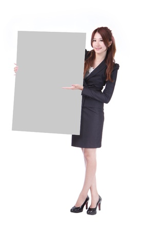 Young Business woman show a blank billboard isolated on white background, model is a asian beauty photo