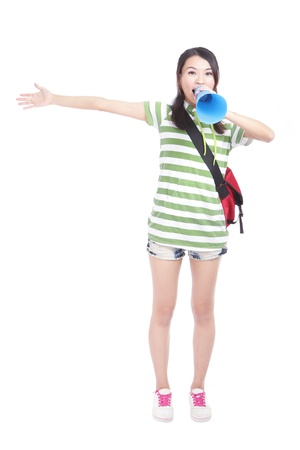 Young girl student yelling and talking to you through megaphone with full length isolated on white background, model is a asian girl photo