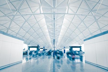 airport with moving blur rush passenger, shot in asia, hong kong photo