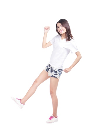 Full length portrait of happy excited girl with white t-shirt and blue jeans isolated over white background, model is a asian woman photo