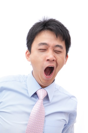 bore: overworked business man yawn with black rim of eye isolated on white background, model is a asian people