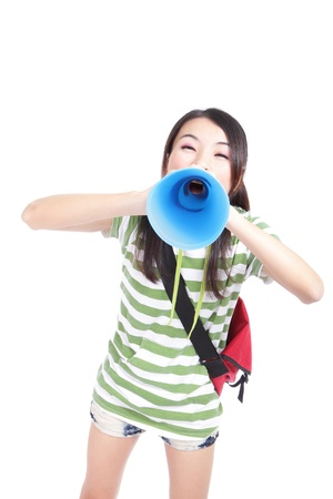 Young girl student yelling and talking to you through megaphone isolated on white background, model is a asian girl photo