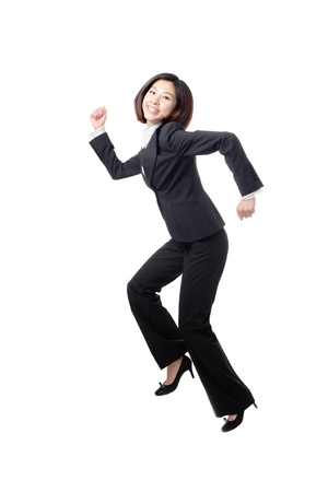 hurry up: pretty business woman happy running and jump very fast in full length isolated on white background, model is a asian beauty Stock Photo