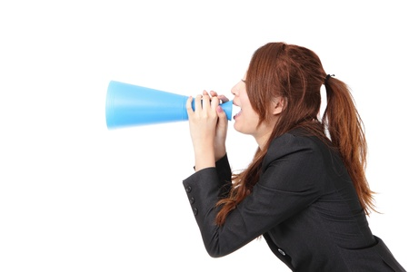 excited business woman yelling through megaphone to empty copy space isolated on white background, model is a asian woman photo