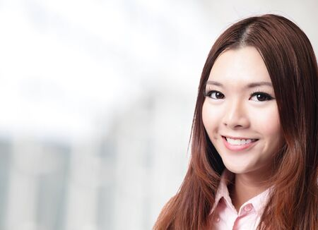charming smile face close up of a beautiful business woman at office, model is a asian beauty Stock Photo - 14174317