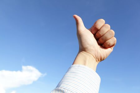 good hand gesture close up with blue sky and white cloud Stock Photo - 14471387