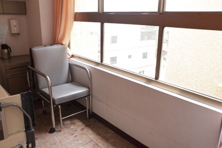 chair in hospital room with window photo