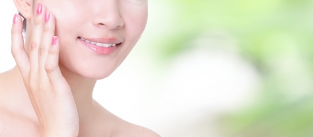 Beautiful woman smile mouth and lips with health teeth close up on nature green background, concept for skincare and dental health care , model is a asian girl photo
