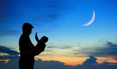 crescent moon: Silhouette of father and child on beautiful summer sunset with half crescent moon - family