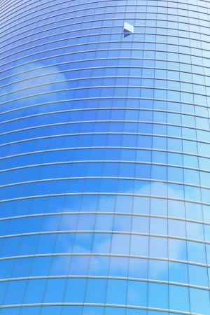 modern business building and window reflection the blue sky and cloud photo