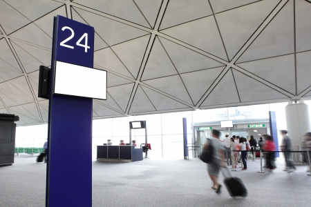 airport people: departure gate with rush passenger moving in the airport, shot in asia