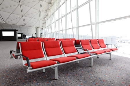 row of red chair at airport, shot in asia photo