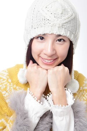 close up Charming smile face of young girl in warm clothing (winter  autumn sweater and ) isolated on white background, model is a asian woman photo