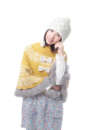 Charming smile of young girl in warm clothing (winter  autumn sweater and ) isolated on white background, model is a asian woman photo